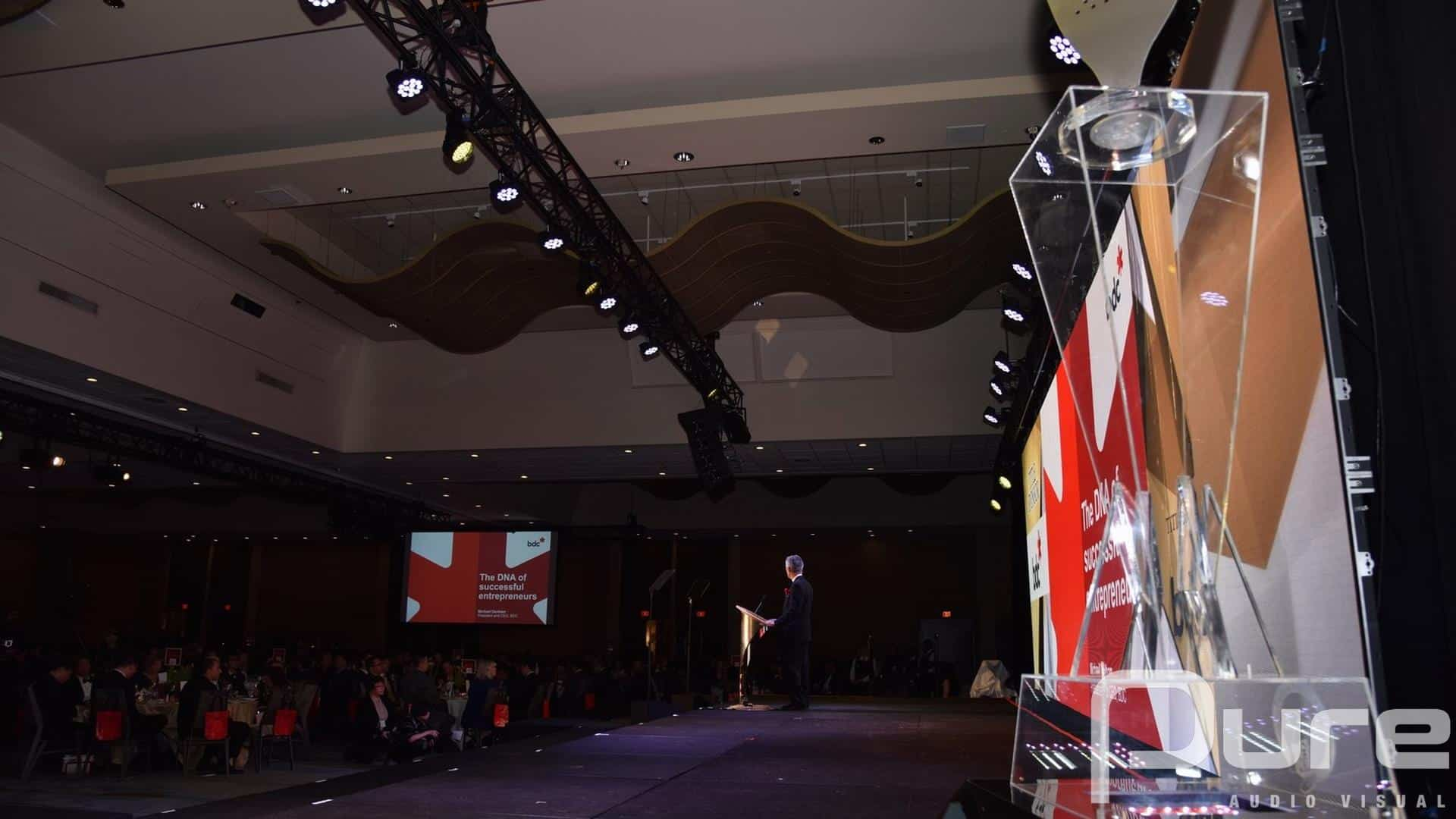 Audio Visual production for an awards gala with LED video wall, projectors, screens, truss, lekos, parcans