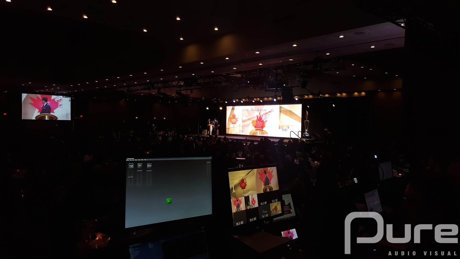 An audio visual production for an awards gala with LED video wall, projectors, screens, stage, lekos, line array, and washlights